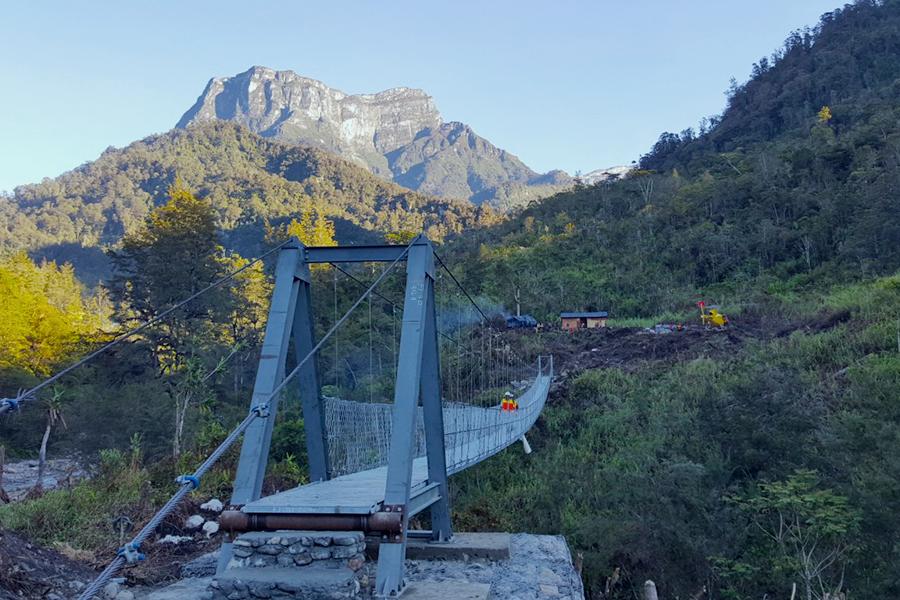 PTFI Hands Over Two Suspension Bridges to Community in Hoya District